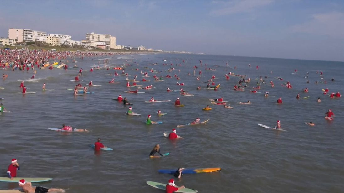 Hundreds of surfers dressed as Father Christmas took to the sea in Florida