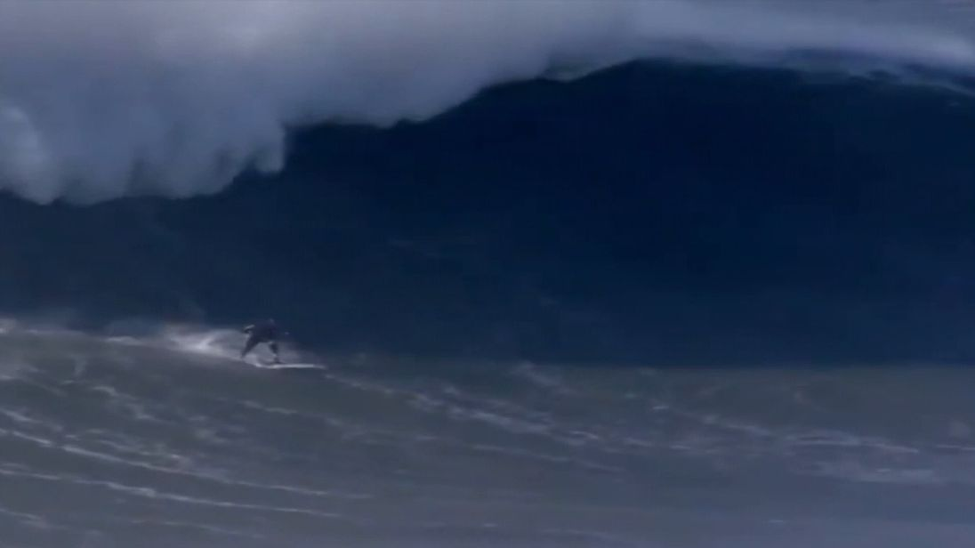 A surfer broke his back on a 50ft wave