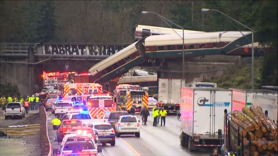 Amtrak train derails off overpass and flips onto highway in Washington state