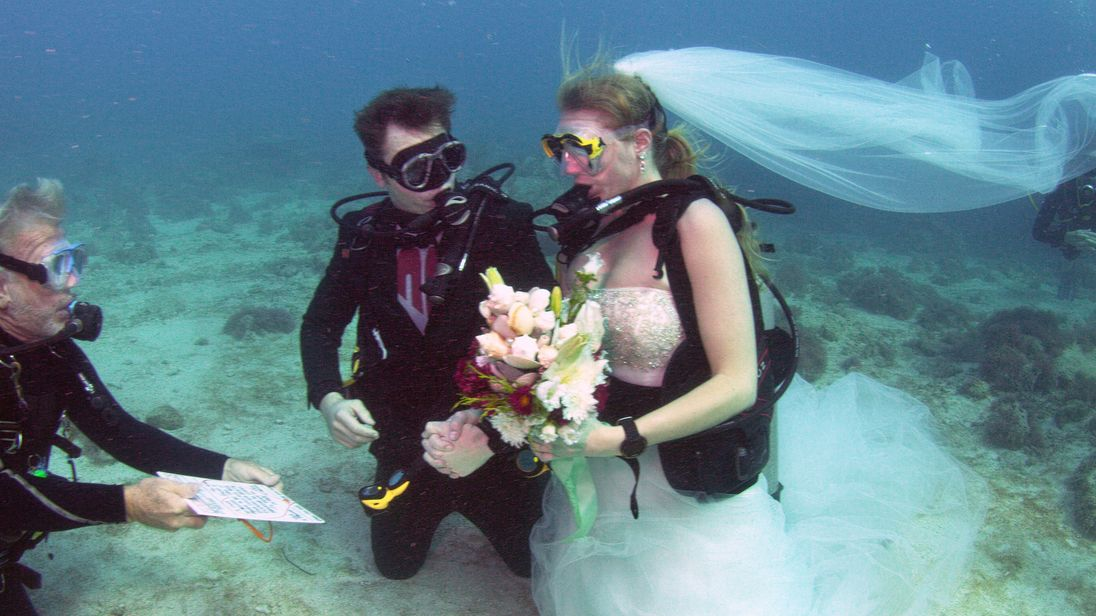 British Army Sergeant Thomas Mould and Sandra Hyde during an underwater wedding ceremony in the Florida Keys National Marine Sanctuary.