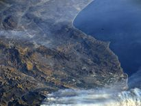 A photo taken from the International Space Station shows smoke rising from wildfires burning in Southern California. Pic: @AstroKomrade/NASA