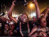 People react after counting down to New Year's day on January 1, 2018, during the New Year's music event at Kenyatta International Convention Centre (KICC) in Nairobi, Kenya