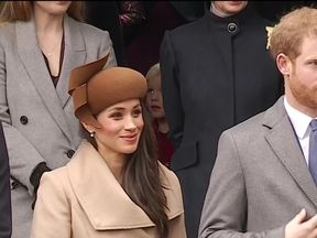 Meghan Markle curtsies to the Queen at Sandringham at Christmas