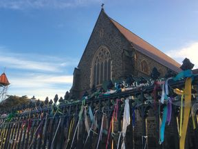 Ribbons tied to the fence outside St Patrick's Cathedral, to remember victims of abuse