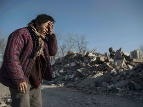 Chinese woman Zheng Yuzhi, 59, whose apartment was demolished by authorities