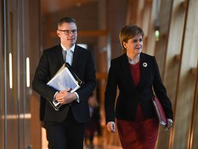 Finance Secretary Derek Mackay and Scotland's First Minister Nicola Sturgeon arrive at the Scottish Parliament ahead of Mr Mackay's draft Budget announcement