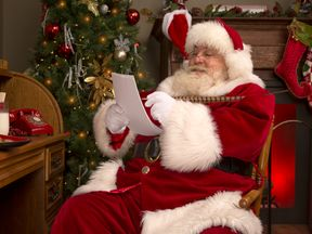 Portrait of the Real Santa Claus writing a letter