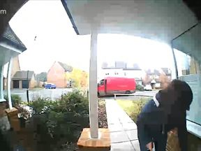 The woman is seen grabbing the parcel before jumping into a van