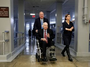 Senator John McCain heads to cast his vote on Capitol Hill earlier this month