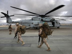 Marines shown boarding a CH-53 in Afghanistan in 2009