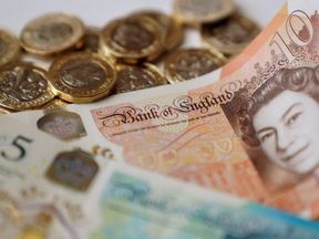 A record £1.1bn in overpaid benefits was recovered from fraudsters last year