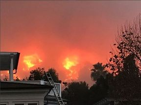 Actor Rob Lowe posted a snap showing a wall of flame just yards from his LA home