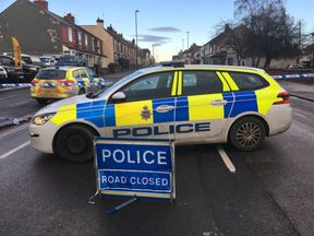 Police closed a main road into Chesterfield as part of anti-terror raids in Derbyshire and South Yorkshire