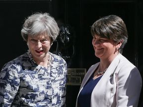 Britain's Prime Minister Theresa May (L) poses for a picture with Democratic Unionist Party (DUP) leader Arlene Foster at 10 Downing Street in central London on June 26, 2017