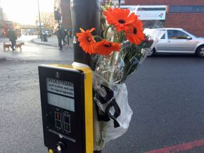 Flowers in Tulse Hill, south london near to where the woman was hit by four different vehicles