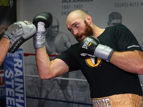 BOLTON, ENGLAND - NOVEMBER 06:  Tyson Fury in action during a training session at Team Fury Gym ahead of his fight with Dereck Chisora on November 6, 2014