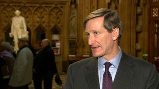 Conservative Dominic Grieve MP talking Westminster lobby.