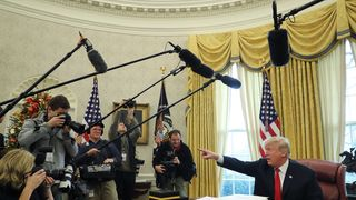Press photographers take pictures of Donald Trump
