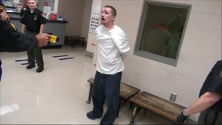 A guard fires a Taser at an inmate in Franklin County jail.