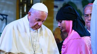 Pope Francis meets with a Rohingya refugee during an interreligious meeting at the Archbishop's house in Dhaka.