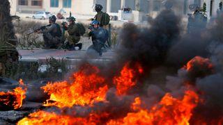 Israeli troops clash with Palestinian demonstrators in Ramallah
