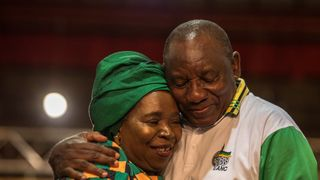 Newly elected African National Congress (ANC) President Cyril Ramaphosa is congratulated by Nkosazana Dlamini-Zuma after his election
