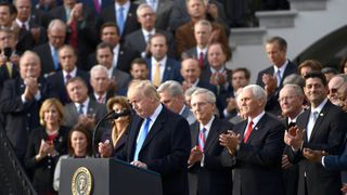 Republicans applaud the President at an event to celebrate tax cuts
