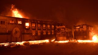 Horse trailers are destroyed after an early-morning Creek Fire that broke out in the Kagel Canyon area