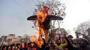 Demonstrators burn an effigy depicting Donald Trump in Srinagar, India