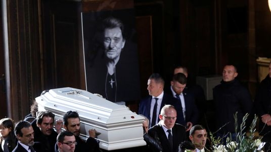 Hallyday's body lay in a white coffin