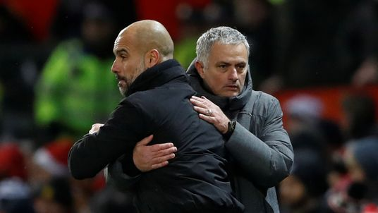 Jose Mourinho (R) acknowledges Pep Guardiola after United's 2-1 defeat to City