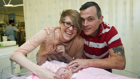 Three-week-old Vanellope Hope Wilkins with her delighted parents
