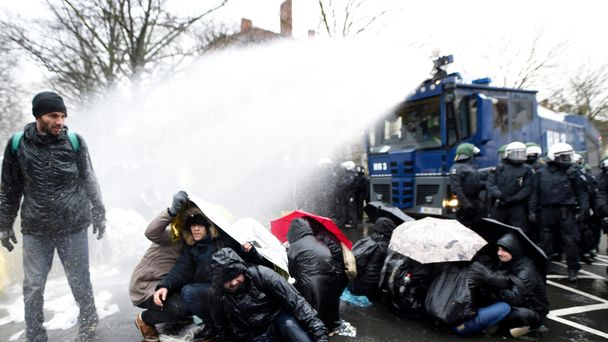 Police fire water cannon outside far-right rally