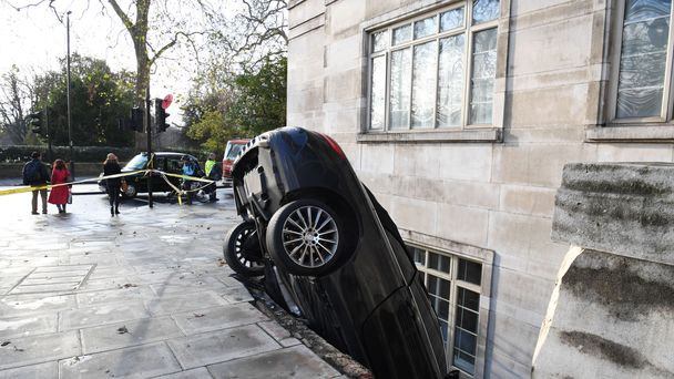 Mercedes smashes into basement of luxury flat