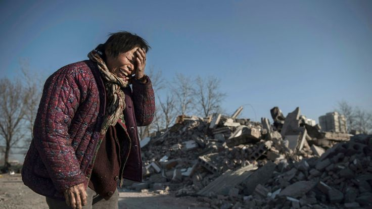 Chinese woman Zheng Yuzhi, 59, whose apartment was demolished by authorities