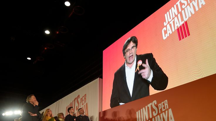 Carles Puigdemont addresses the party faithful via video link