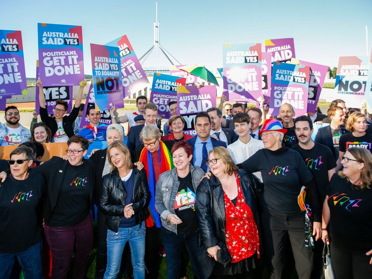 Campaigners gather outside Parliament House in Canberra for the vote