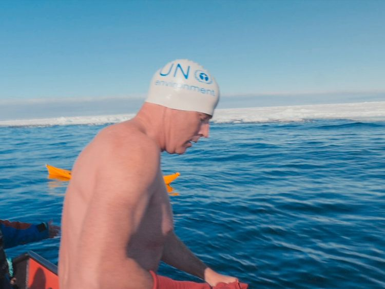 UN Patron of the Oceans Lewis Pugh preparing to swim near the Arctic ice sheet