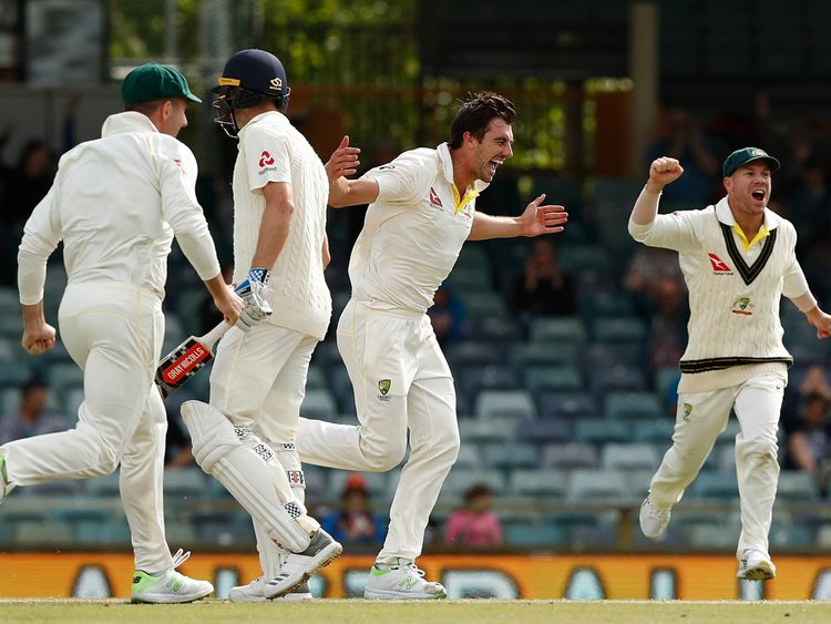 Pat Cummins celebrates after taking the final wicket to seal the Ashes win