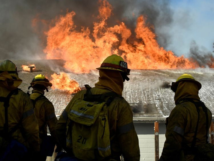 Two people burned in California wildfires