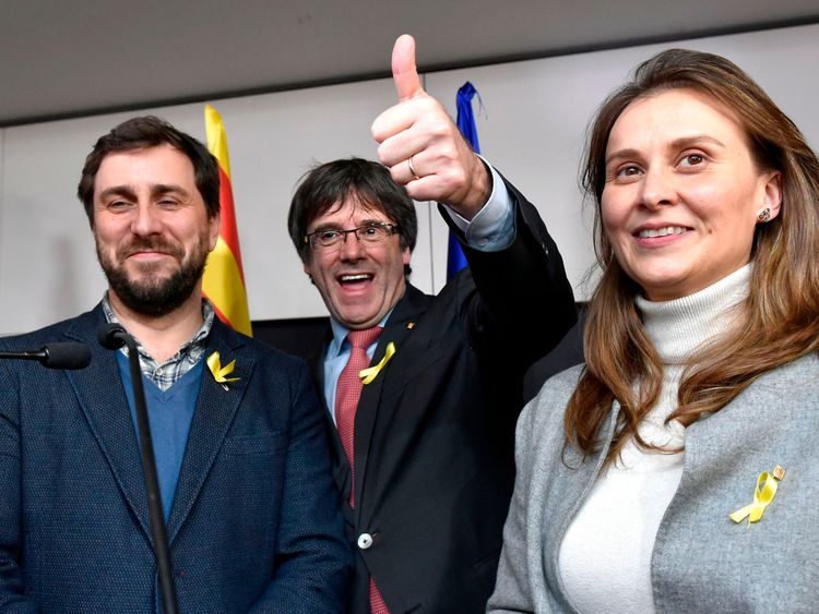Axed Catalan president Carles Puigdemont, flanked by former Catalan Health minister Antoni Comin (L) and former Catalan Minister of Agriculture, Livestock, Fisheries and Food Meritxell Serret (R), reacts after the results of the regional elections in Catalonia at the Square - Brussels Meeting Centre in Brussels on December 21, 2017. Catalan separatists won a crucial snap poll on December 22, 2017, plunging their region into further uncertainty after a failed independence bid rattled Europe and t