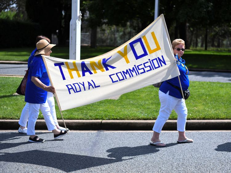 Members of the Care Leavers Australasia Network (CLAN) hold up a banner thanking the Commission as they await the final report from the Royal Commission into Institutional Responses to Child Sexual Abuse