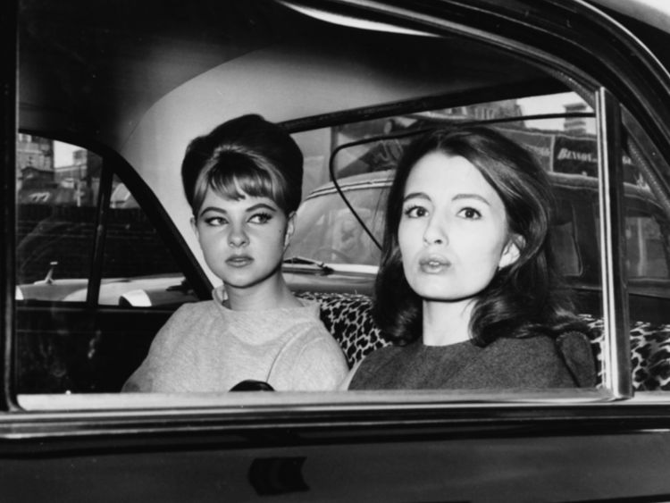 Mandy Rice-Davies (left) and Christine Keeler leave court following the trial of Stephen Ward