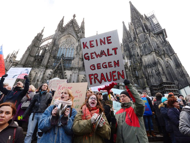A man holds up a sign reading 'No violence against women' as he takes part in a demonstration in front of the cathedral in Cologne, western Germany, on January 9, 2015 where sexual assaults in a crowd of migrants took place on New Year's Eve. / AFP / Roberto Pfeil (Photo credit should read ROBERTO PFEIL/AFP/Getty Images)