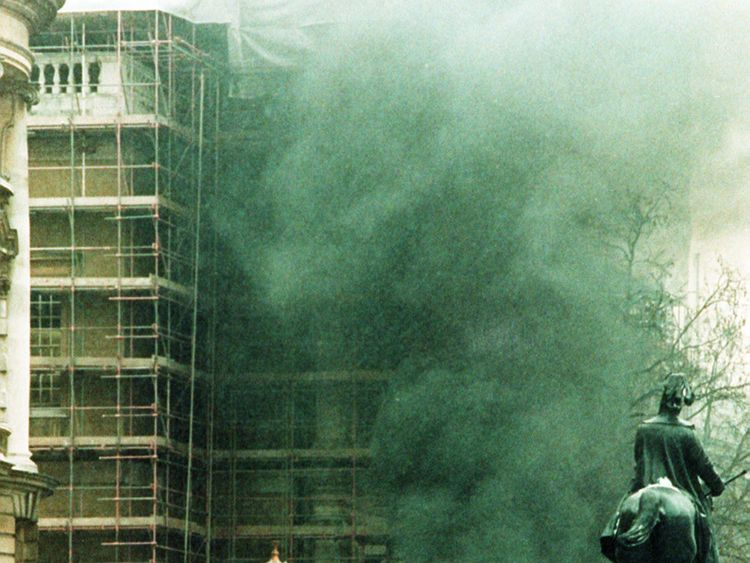 Smoke billows from a burning van following the 1991 mortar attack on Downing Street