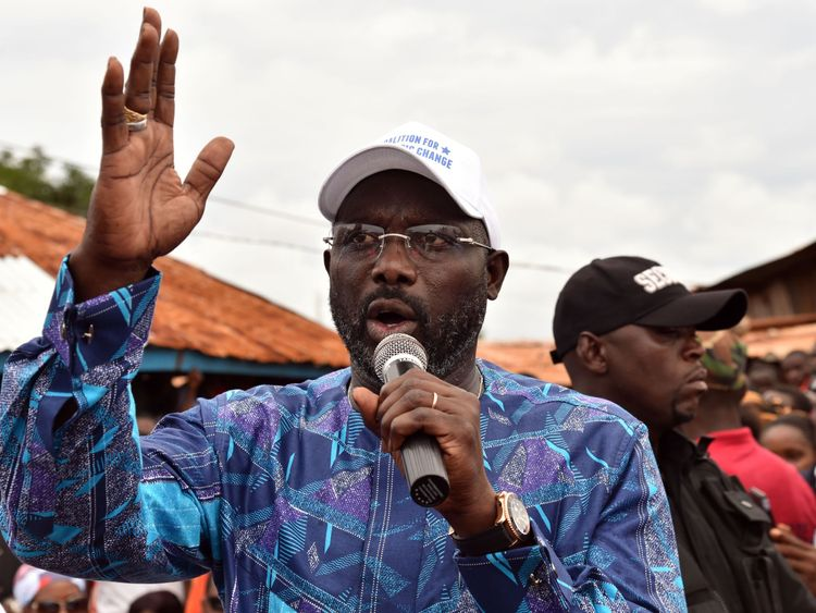 Former international Liberian football star turned politician George Weah, addresses supporters during a campaign rally in Monrovia on October 8, 2017, three days ahead of the country's elections. Liberians go to the polls on October 10, to pick their first new president in 12 years as Ellen Johnson Sirleaf closes the page on two terms dominated by post-war reconstruction and the Ebola crisis. / AFP PHOTO / ISSOUF SANOGO (Photo credit should read ISSOUF SANOGO/AFP/Getty Images)