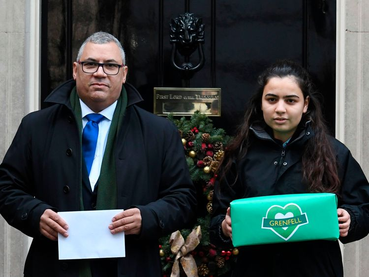 Grenfell Tower survivor Nicholas Burton presents a petition to Theresa May calling for an independent panel to sit alongside the judge in the inquiry into the disaster