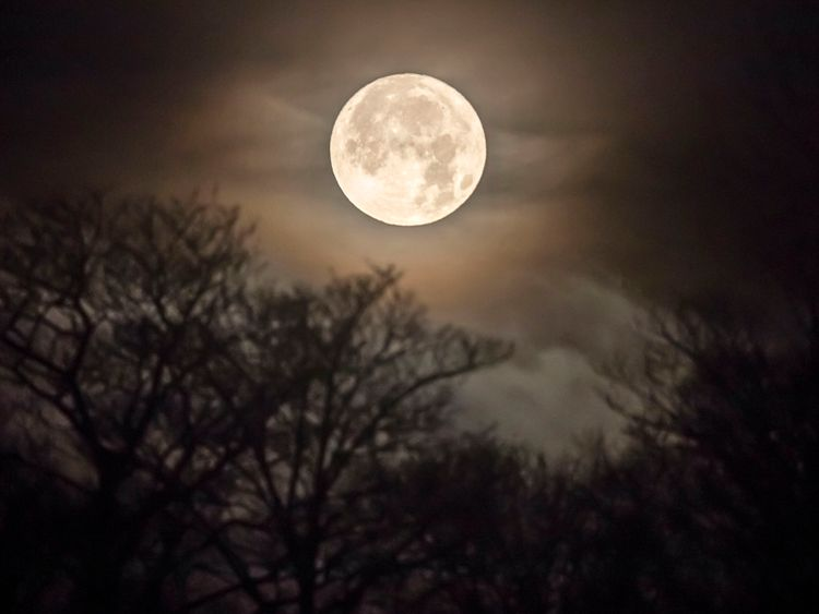 The moon sets over Huddersfield in Yorkshire this morning.