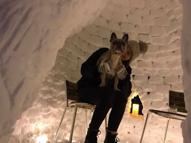 Ben's girlfriend Jodie enjoys the 'really warm' igloo. Pic: Benjamin Crutch/Facebook