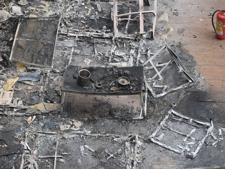 EDITORS NOTE: Graphic content / A burnt dining table is seen among the charred remains of a restobar where a rooftop party was being held in Mumbai early on December 29, 2017. At least 14 people were killed when a huge blaze tore through a popular restaurant in Mumbai early December 29, police said, in the latest disaster to raise concerns over fire safety in India. / AFP PHOTO / INDRANIL MUKHERJEE (Photo credit should read INDRANIL MUKHERJEE/AFP/Getty Images)